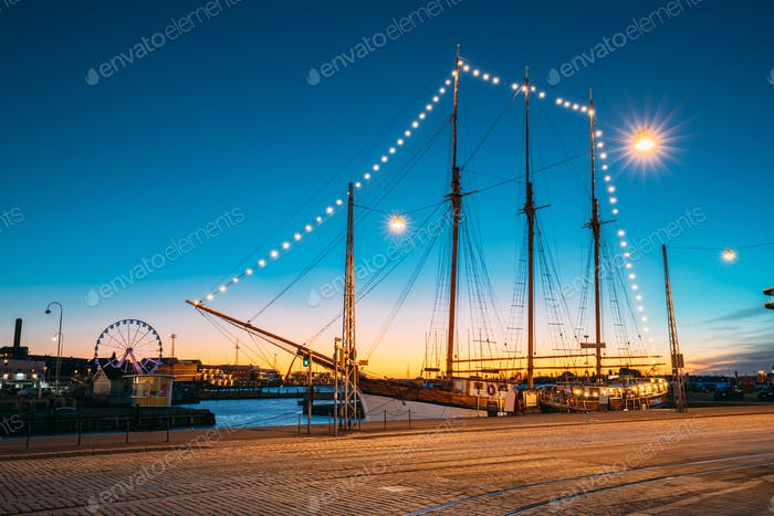Helsinki, Finland. Old Wooden Sailing Vessel Ship Is Moored To The City Pier, Jetty. Unusual Cafe
