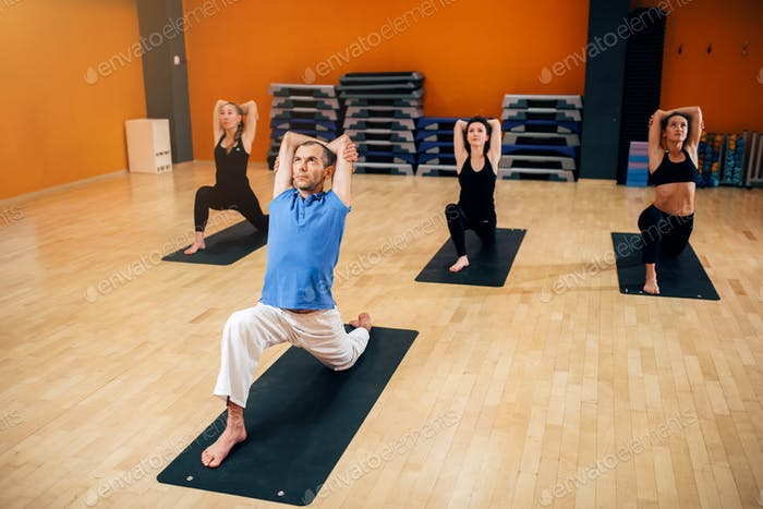 Yoga, female group with instructor in motion