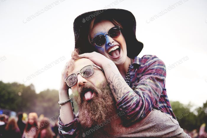 Happy couple at music festival