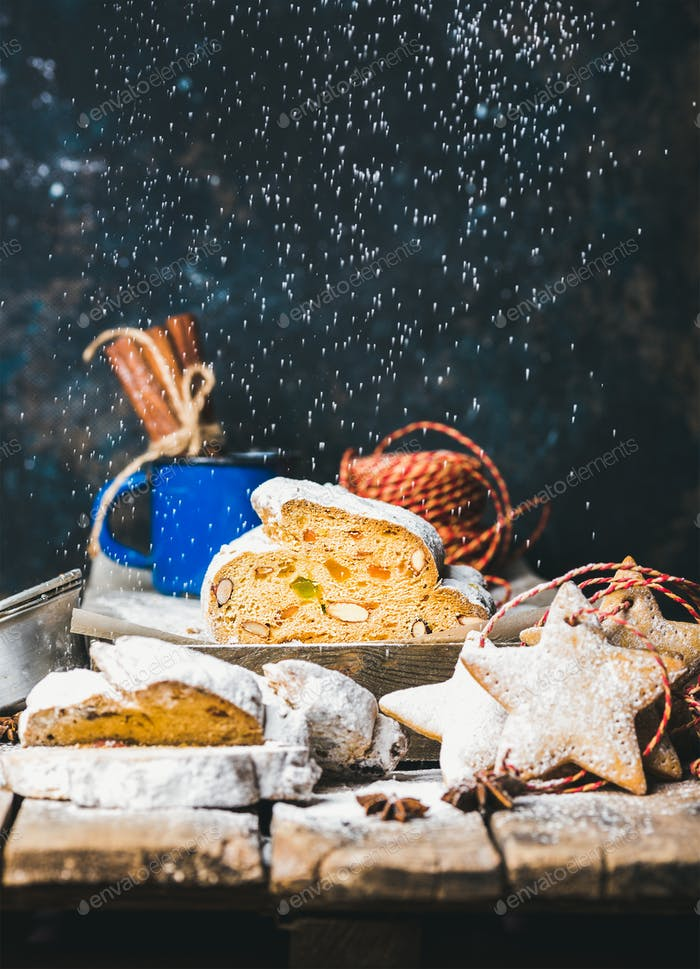 Traditional German Christmas cake Stollen with gingerbread star-shaped cookies