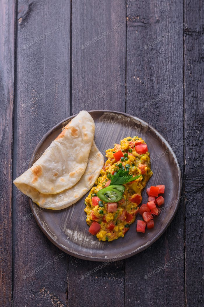 Indian omelette with spices and tomatoes, copy space