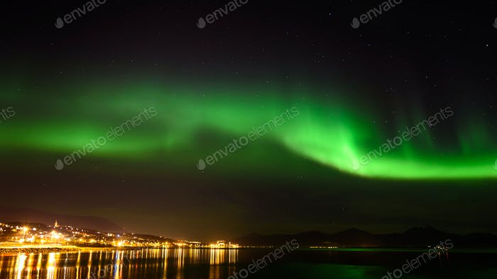 A beautiful green Aurora borealis or northern lights in the sky at Tromso, Norway