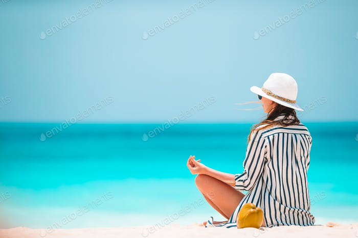Body of beautiful woman in a meditation on the beach