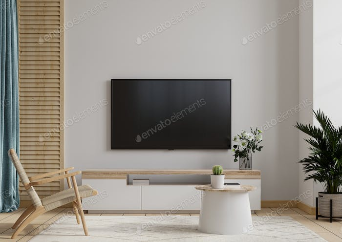 TV lounge with armchair on white wall background.