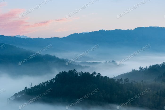 rosy clouds and misty blue mountains