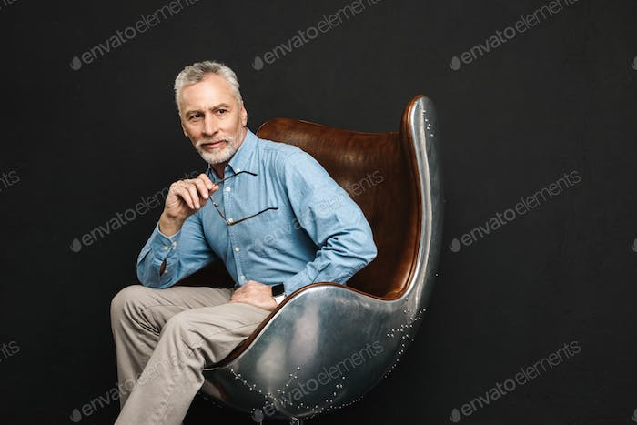 Image of businesslike gentleman 50s with grey hair and beard in