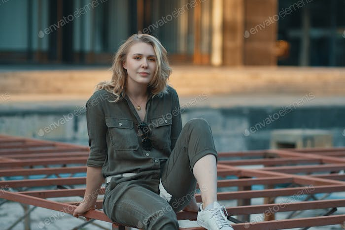 Young modern woman posing in the city, outdoors. Urban life