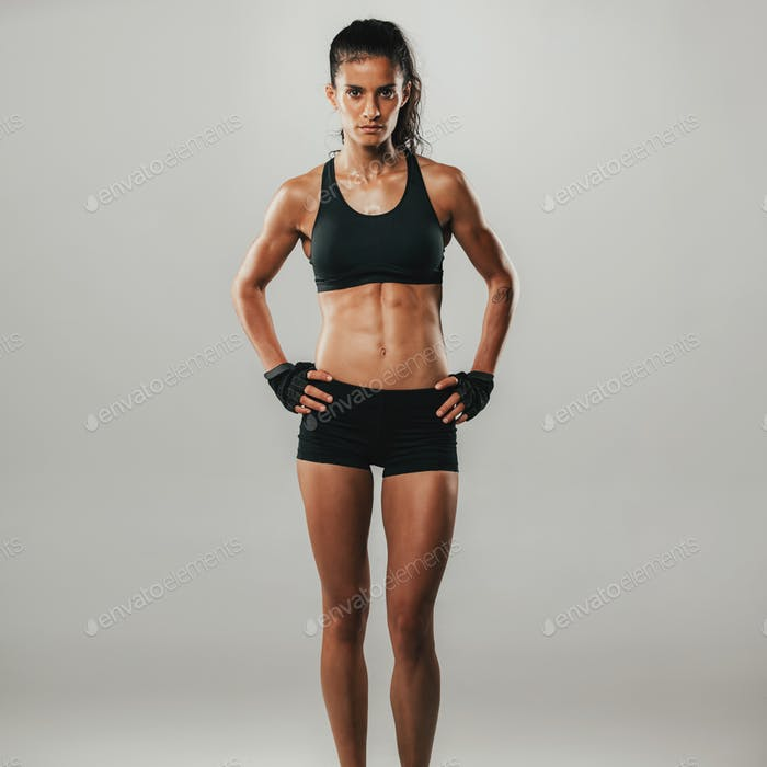 Fit healthy young woman with a strong body