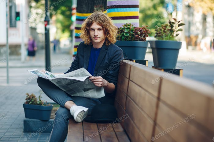 Fashionable hipster with newspaper