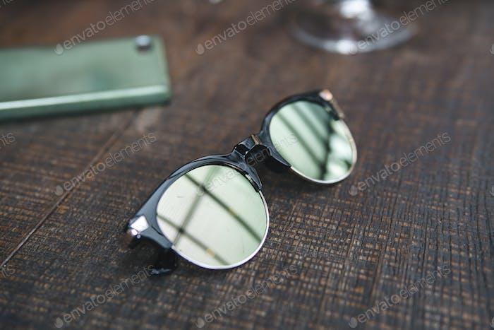 sun glasses on a restaurant table