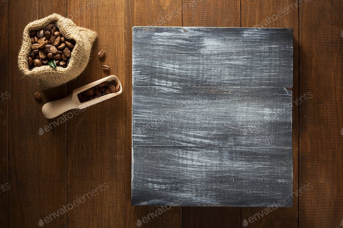 coffee beans in bag on wood
