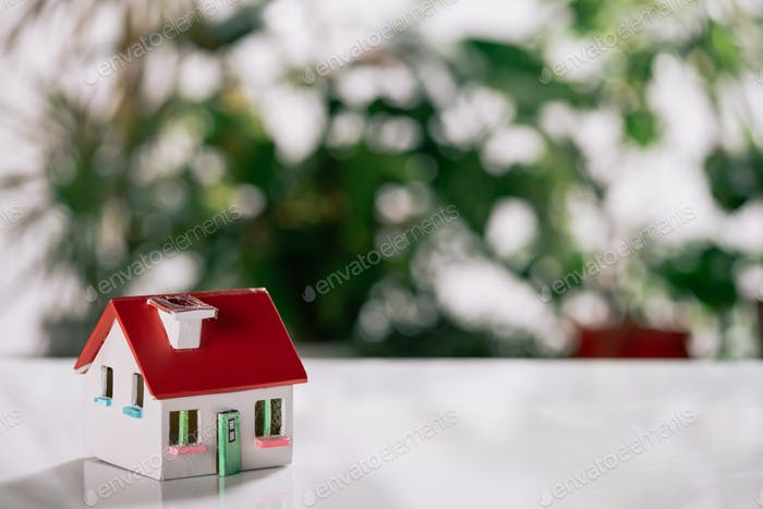 selective focus of house model on white desk, mortgage concept