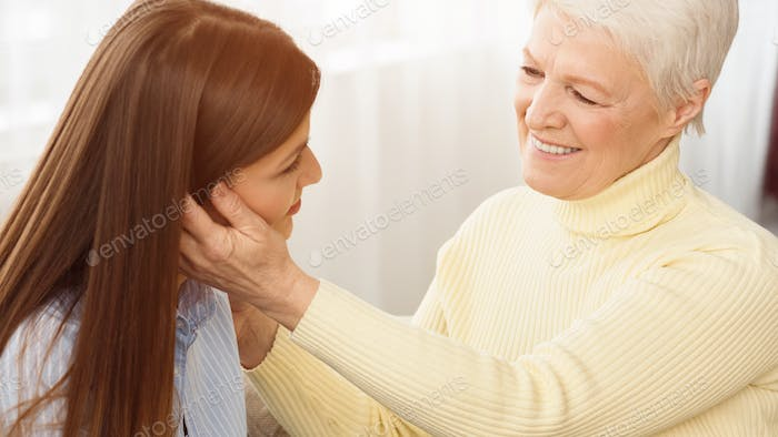 Mother tenderness. Happy mom and daughter spending time together