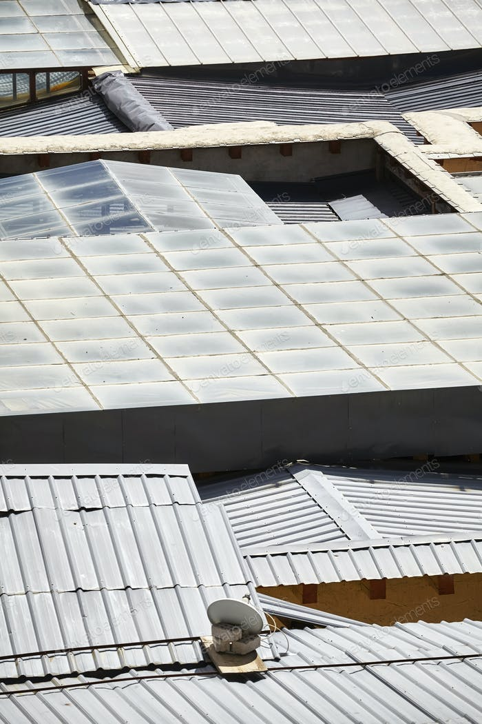 Aerial picture of roofs made or corrugated sheets.