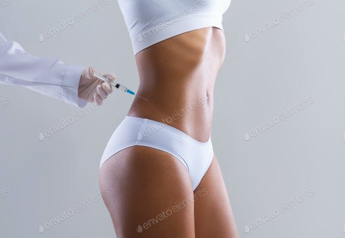 Cropped of afro woman having lipolysis treatment at beauty salon