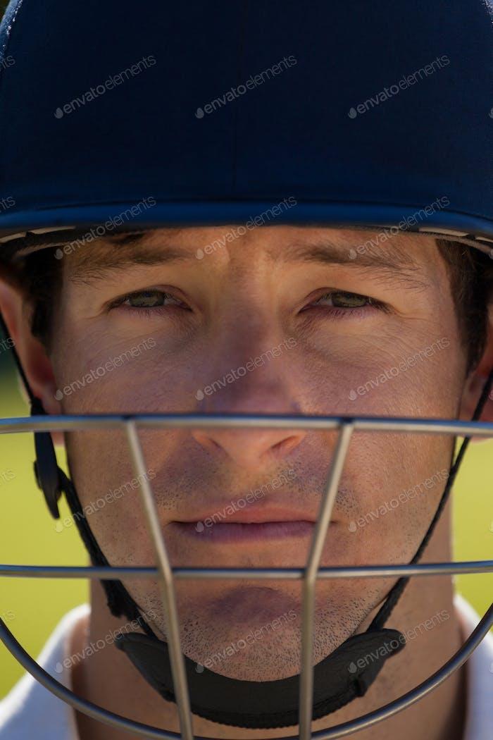 Close up portrait of cricket player wearing helmet