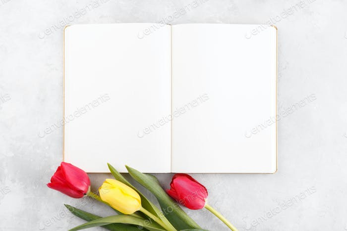 Open notepad and flowers