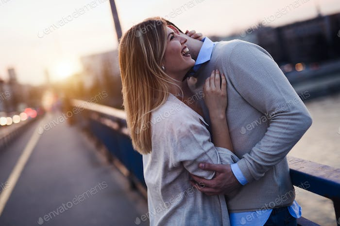 Happy romantic couple hugging and smiling