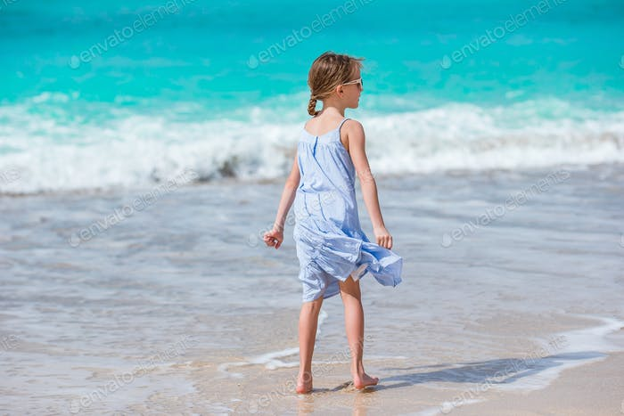 Happy girl enjoy summer vacation on the beach