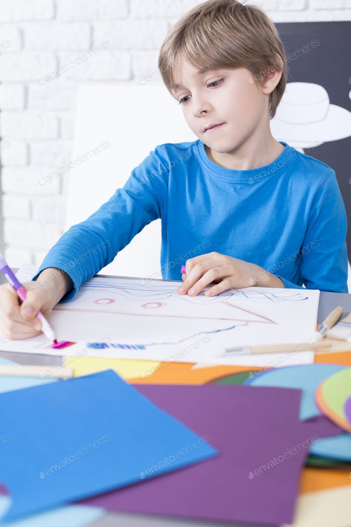Boy coloring the picture
