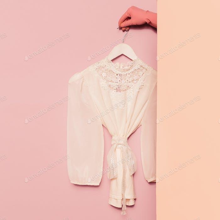 Stylish clothes. Romantic fashion. White shirt lace vintage on t