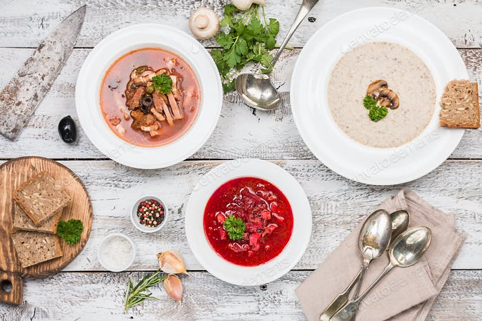 Three bowls with different soups