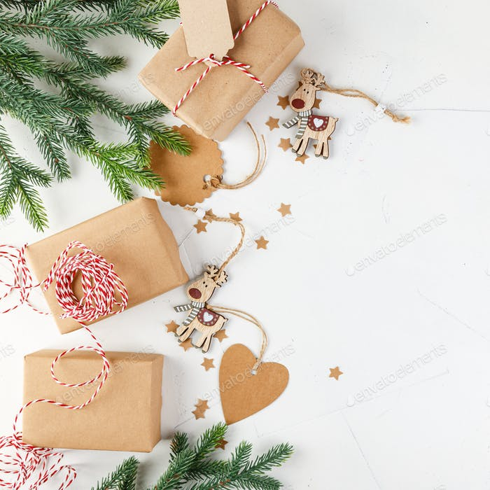 Christmas giftbox and presents wrapping in craft paper and decor
