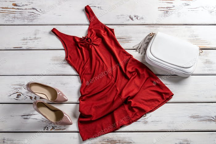 Red dress and heel shoes.