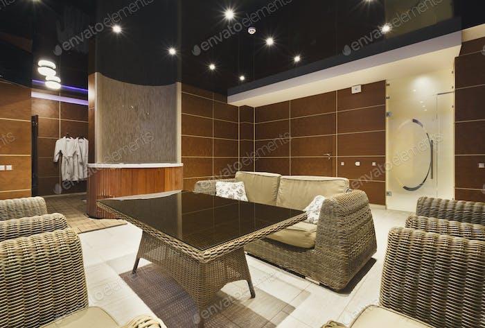 Modern hotel lobby with wicker furniture