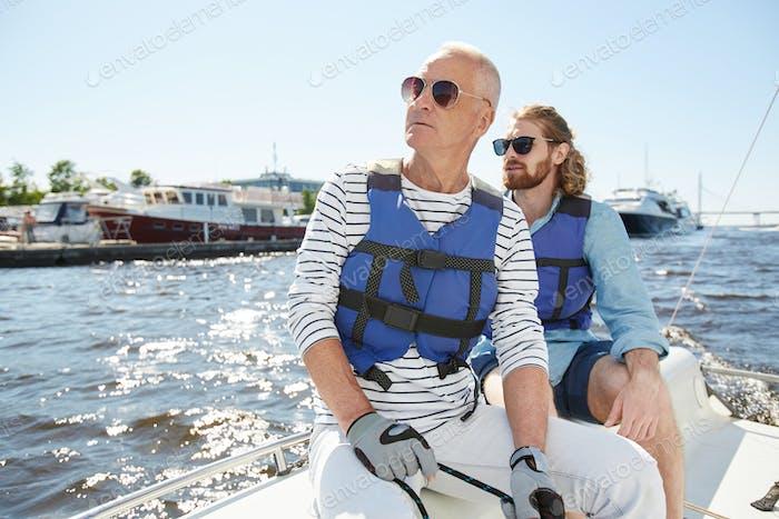 Tourists looking around during sailing tour