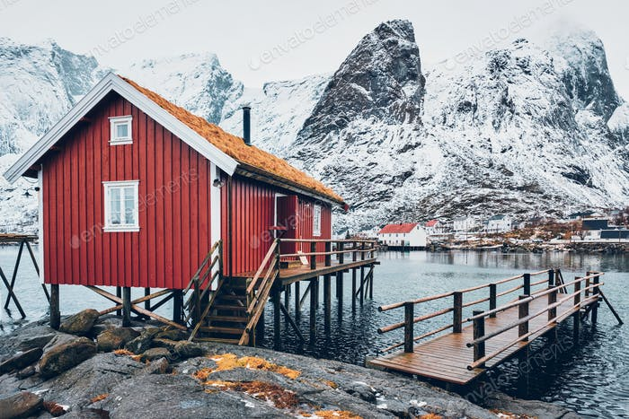 Traditional red rorbu house in Reine village on Lofoten Islands