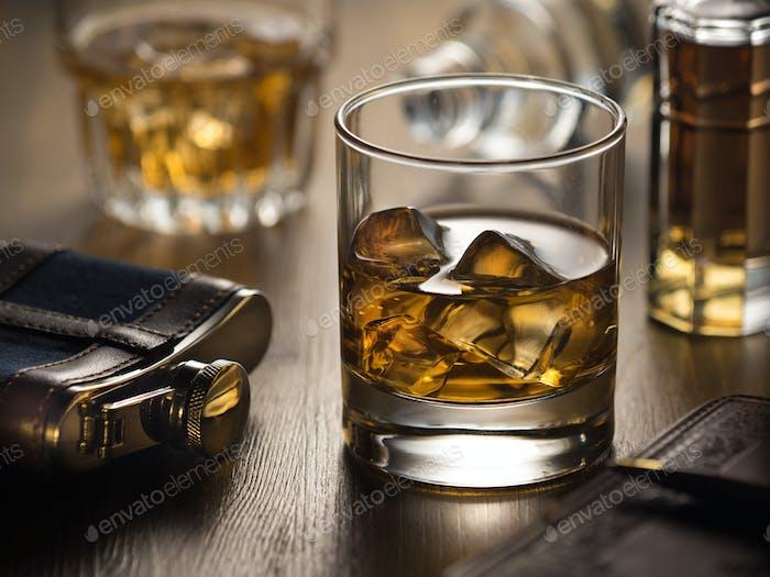 Backlit glass of whisky on the rocks