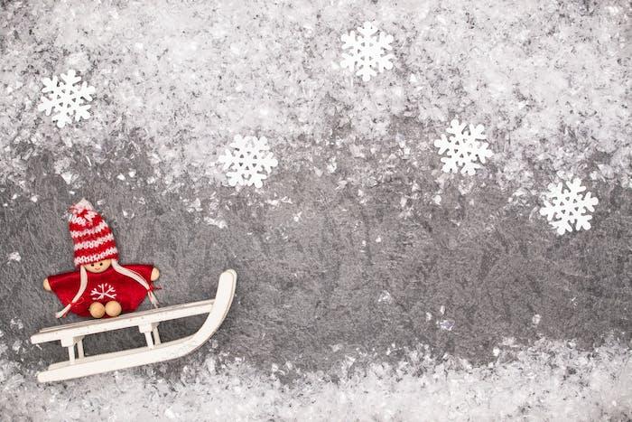Weihnachts-Grußkarte Noel festlicher Hintergrund. Neujahrssymbol. Kinder spielen Thema.