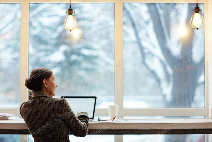 Woman by window
