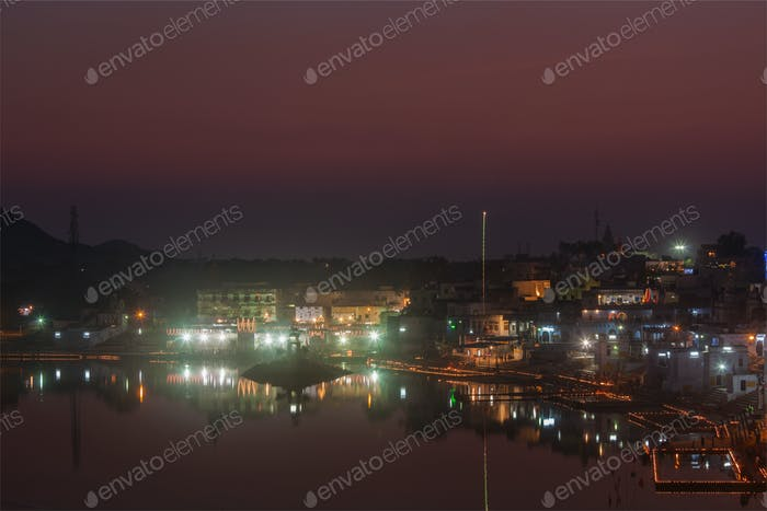 Sacred Puskhar lake (Sagar) and ghats of town Pushkar in twilig