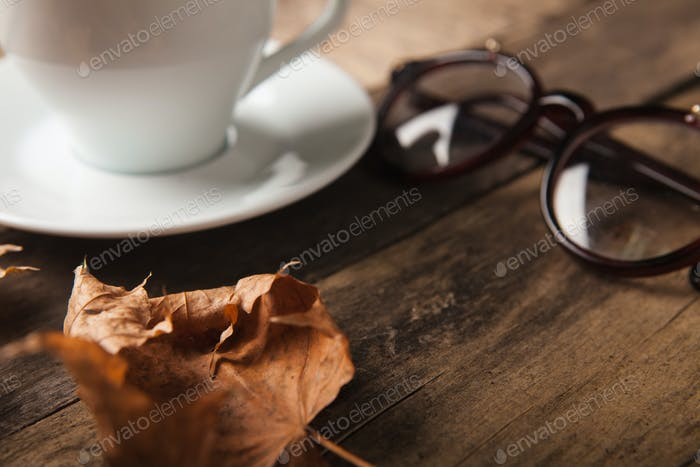 Glasses and cup of coffee on a wooden table