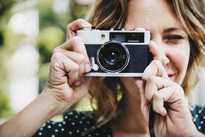 Woman taking picture with camera