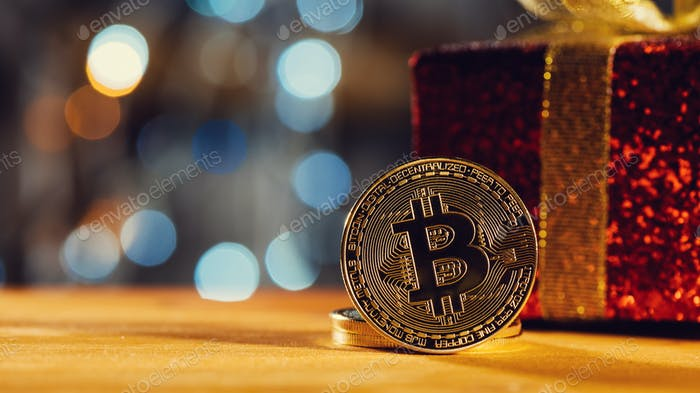 Bitcoin BTC cryptocurrency and Christmas gift box