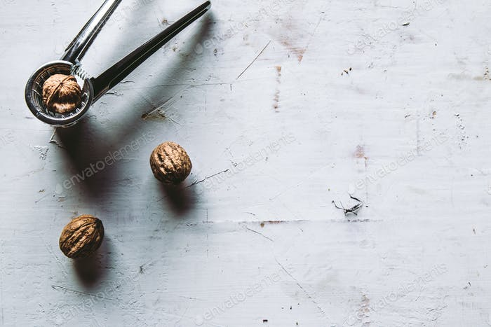 Shelled walnuts with a Nutcracker. On a rustic background