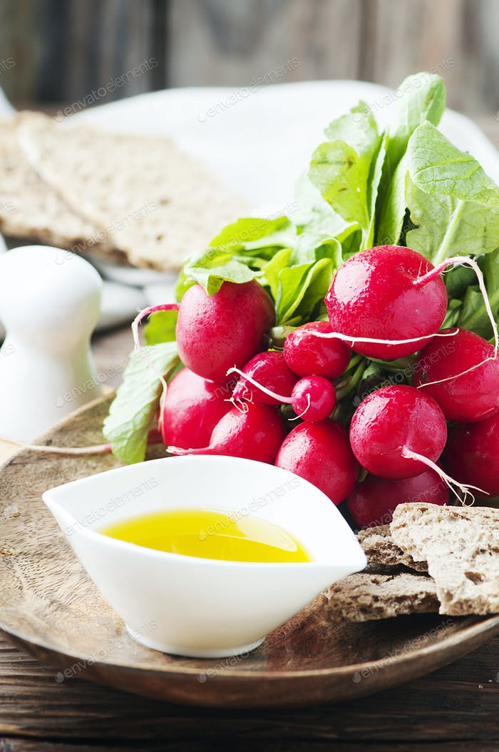 Fresh red radish on the wooden table