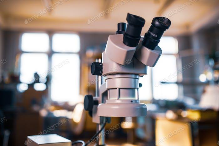 Modern microscope in workshop laboratory