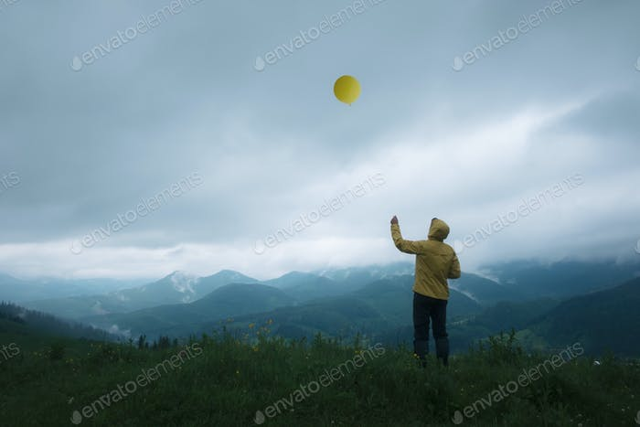 man with balloon