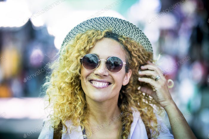 Cheerful beautiful young woman portrait with trendy hat and sunglasses enjoy outdoor