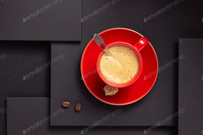 cup of coffee and beans at abstract black background