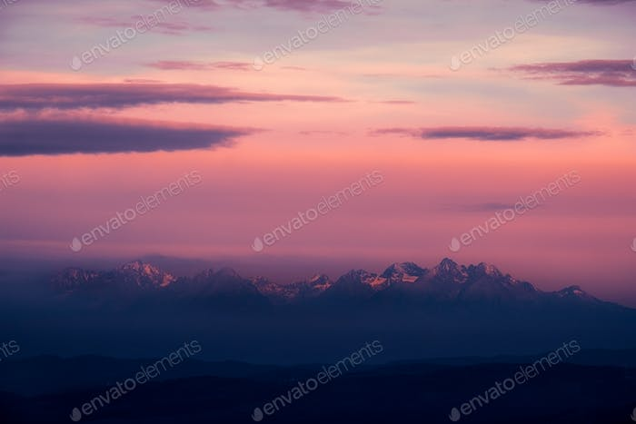 Dramatic sunrise with dark moody mountain range, High Tatras, Slovakia
