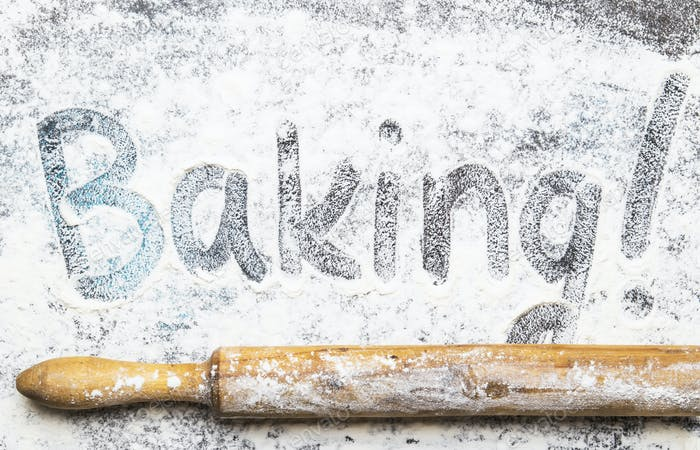 Food or baking background, white flour sprinkled