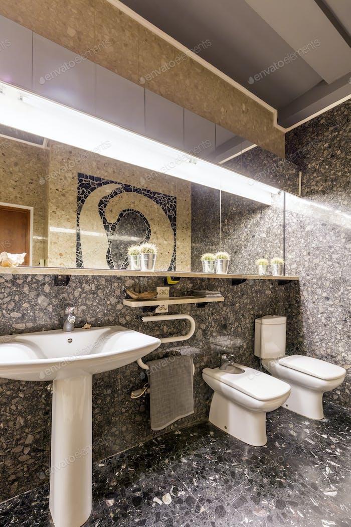 Ethnic bathroom with sink and big mirror