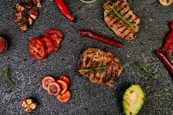 Steak pork grill with a variety of grilled vegetables