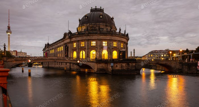 Bode museum illuminated, Spree river, museum island, Berlin, at night