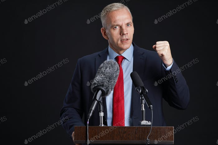 Passionate Mature Man Giving Speech at Podium
